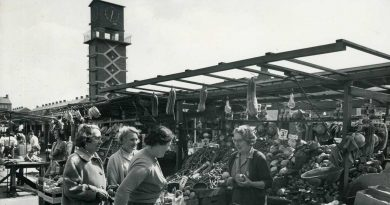 A busy and bustling Chrisp Street Market in 1968 with the Chrisp Street Clock Tower in the background