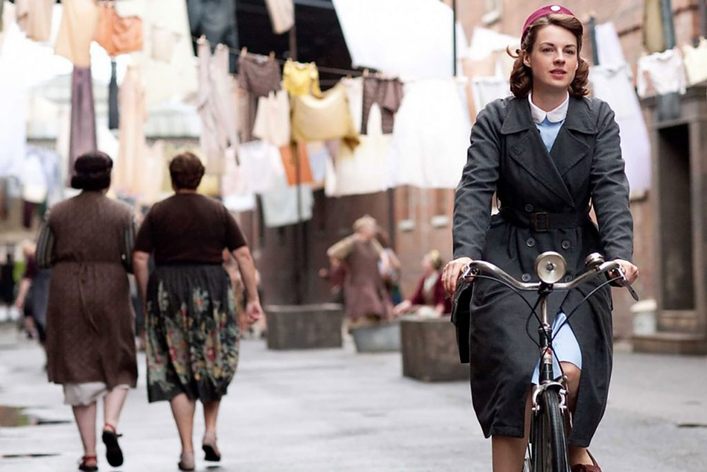 BBC's Call the Midwife poster of Jennifer Worth, actress Vanessa Redgrave, cycles in Poplar