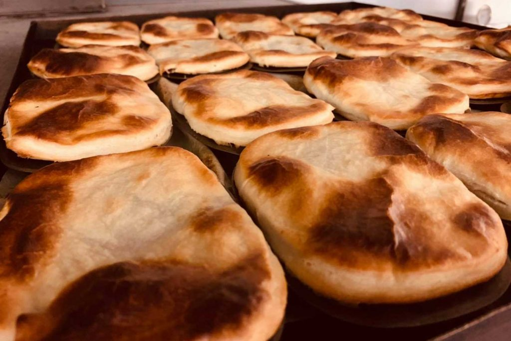 Close up of pies in a tray fresh out the oven