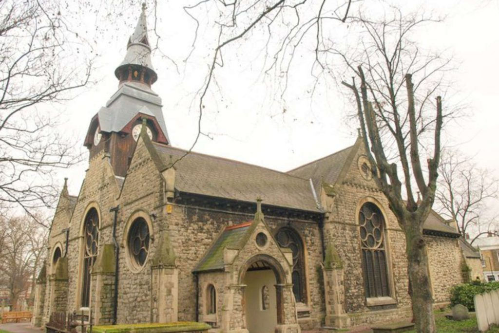 St Matthias, a grey stone church with gothic pointed arches and circular windows