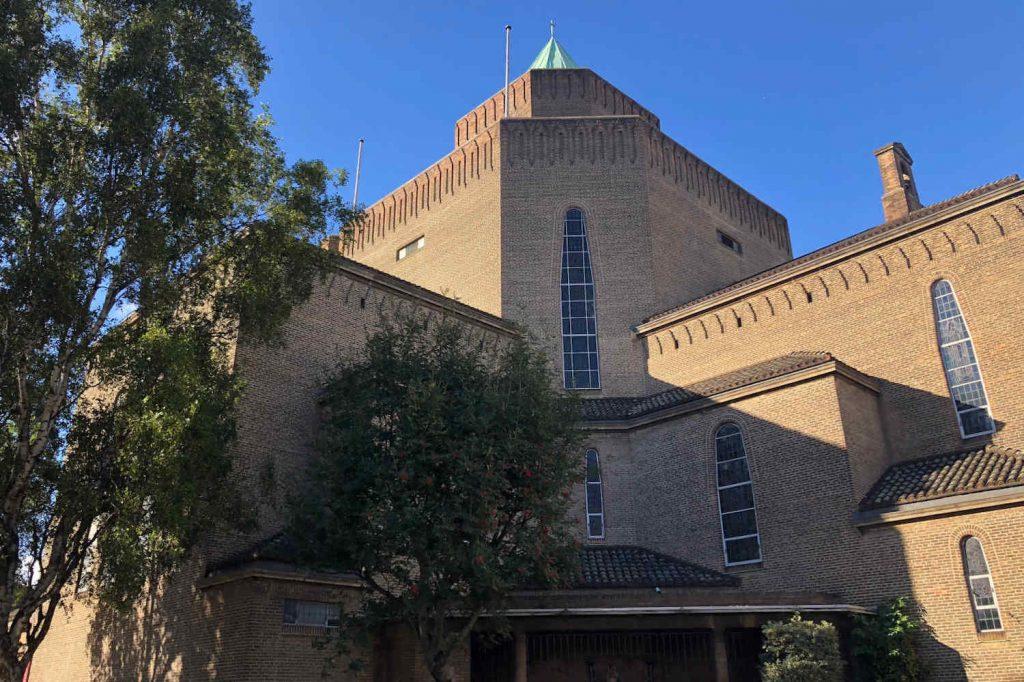 St Mary and St Joseph, a large modern brick church under a blue sky